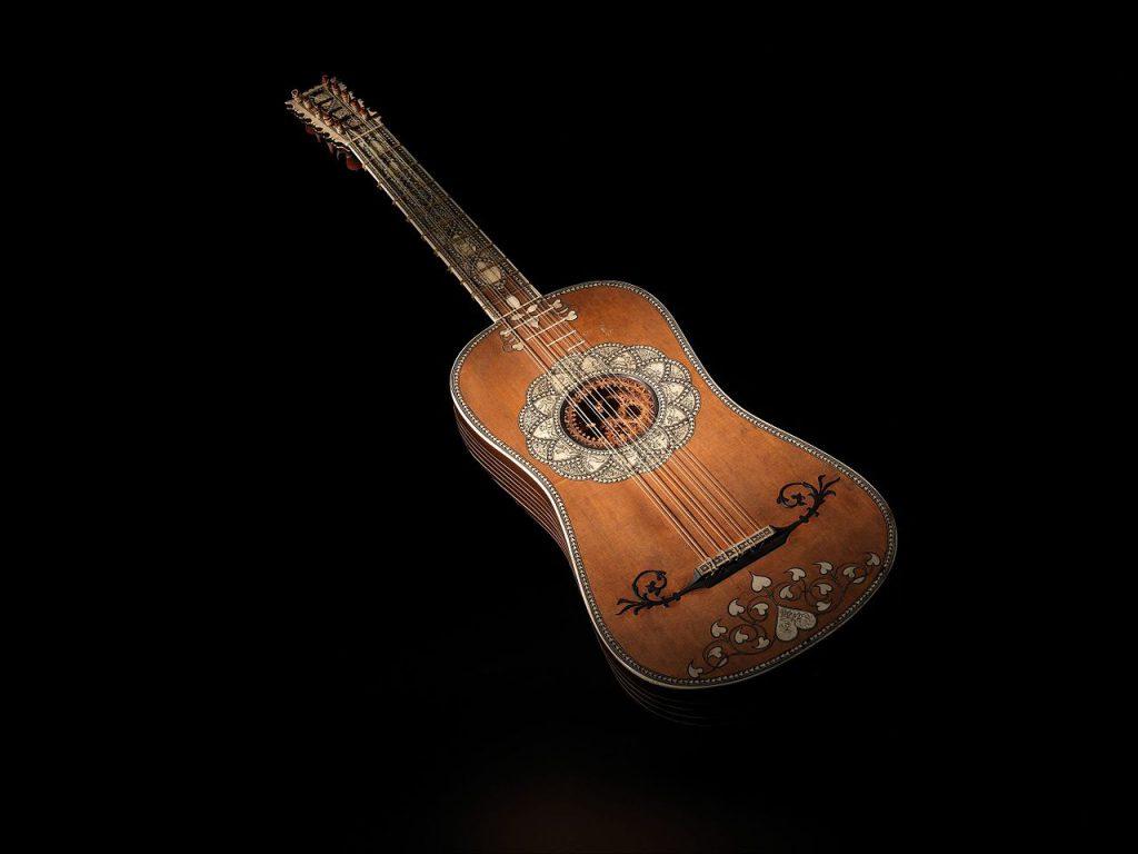 Baroque guitar with ornate decoration on soundboard