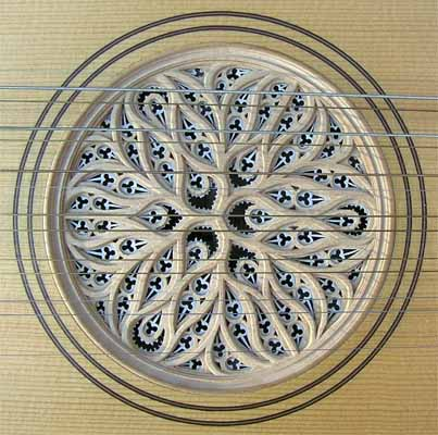 bandora rose in an organic, flowing, radially symmetrical pattern made of wood and parchment