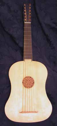 vihuela with wide, guitar-shaped body