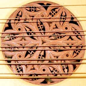 vihuela rose carved in organic, radially symmetrical pattern