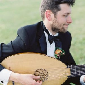 Charles Weaver playing Renaissance lute in formal dress